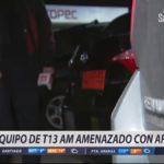 VIDEO |El momento exacto en que equipo de T13 AM fue amenazado con armas en pleno robo durante nota