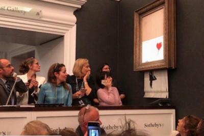 VIDEO   Obra de Banksy se autodestruye después de ser vendida por más de un millón de dólares