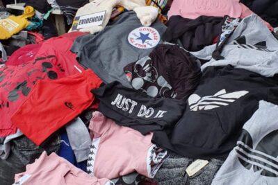 Siete detenidos: descubren cuatro talleres clandestinos que falsificaban ropa deportiva que era vendida en ferias libres